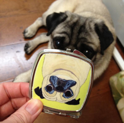 Annie loves what she sees in her new compact mirror!